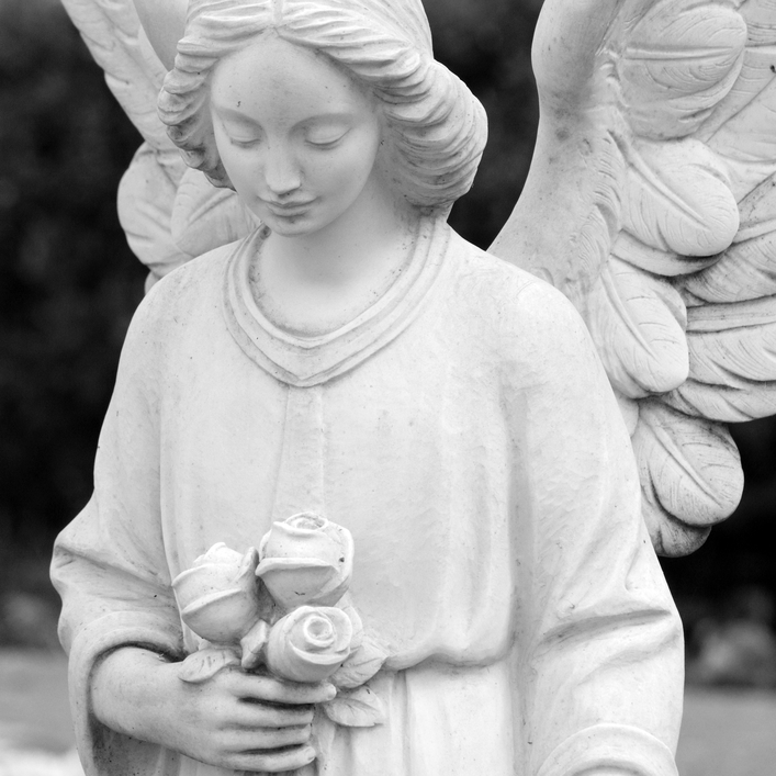 cemetery angel statue holding roses, Italy ,Europe