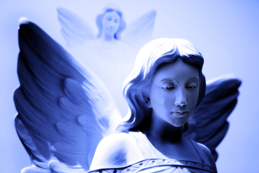 Pair of angel statues with wings looking on